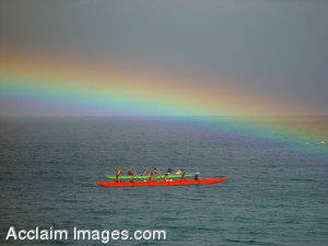 Stock Picture of Outrigger Canoes Under a Rainbow; Maui, Hawaii