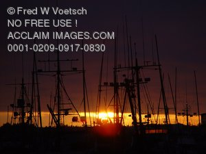 Clip Art Stock Photo of a Sunset Behind a Ship