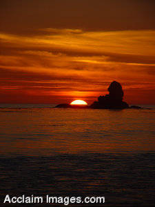 Stock Image of the Sun Almost Set in the Ocean, Cresent City, California