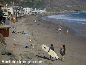 Photo of Surfers and Houses Along Faria Beach