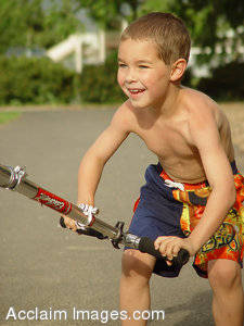 Stock Photography of a Boy Riding a Scooter