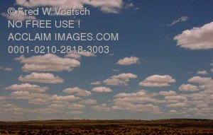 Clouds Over The Desert Photograph