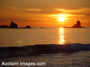 Stock Photograph of a Golden Sunset at Pebble Beach, California