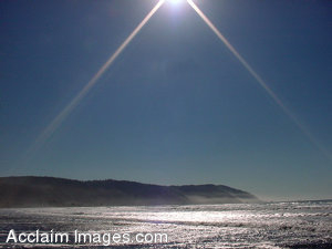 Stock Clipart Photo of the Sun Reflecting on the Ocean