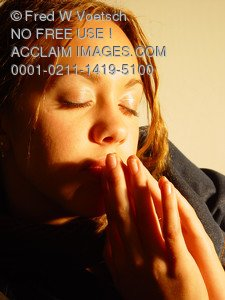 Stock Image of a Teenage Girl in Prayer