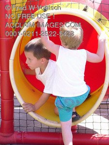 Stock Image of Boys Playing in a Slide