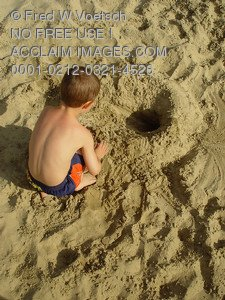 Stock Photo Clip Art of a Child Playing in a Sandbox