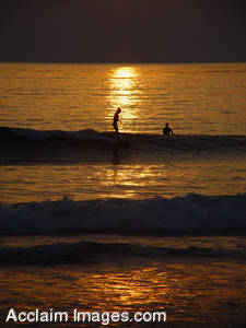 Stock Image of  Two Surfers at Sunset