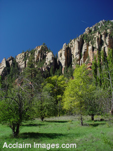 Free Stock Clip Art Photo of a Green Valley and Rock Formations
