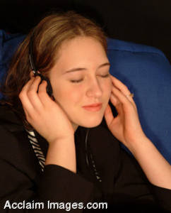 Stock Photo of a Young Girl Listening To Music