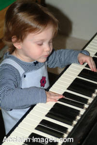 Stock Picture of a Little Girl Playing a Keyboard