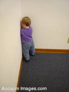 Stock Photo of a Child Standing in a Corner