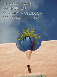 Stock Photo of Planter On a Wall Against a Blue Sky