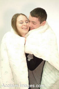 Stock Photo of Two People Wrapped up Together.