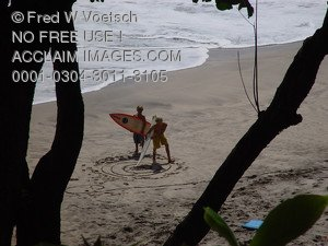 Stock Image of Kids Carrying Surfboards on Hamoa Beach, Maui, Hawaii