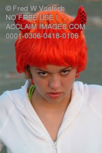Stock Photo of a Teenage Girl in a Devil Costume
