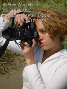 Stock Photo of a Girl With a Camera