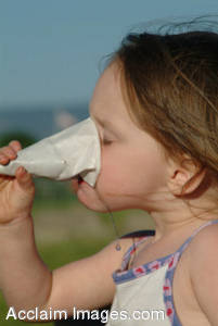 Stock Image of a Little Girl Drinking a Sno-Cone