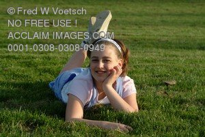 Stock Photo of Girl Lying on a Lawn