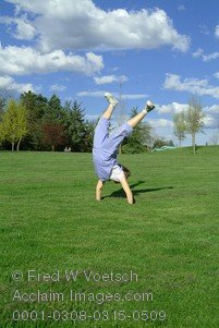 Stock Photo of a Child Doing a Cartwheel