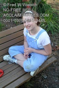 Stock Photo Clip Art of a Young Tween Girl on a Park Bench