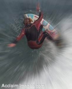 Stock Image of a Surfer Hitting The Lip