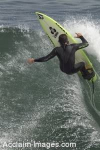 Stock Photo of a Young Guy Riding A Wave