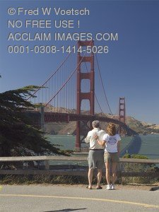 Stock Photo of Tourists Looking at The Golden Gate Bridge