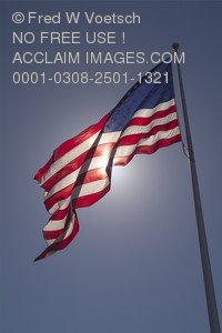 Stock Photo of the American Flag, Backlit by the Sun