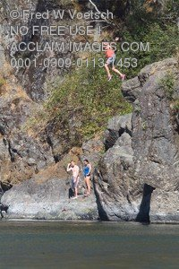 Stock Photo of a Woman Jumping Into Water From Cliffs