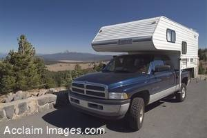 Stock Photo of a Cabover Truck and Camper