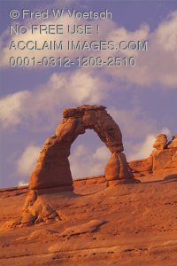 Stock Photo of Delicate Arch Under Clouds