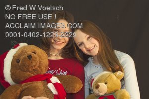 Stock Photo of Two Girls With Christmas Teddy Bears