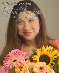 Stock Photo of a Woman Holding Flowers