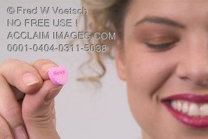 Stock Photo of a Woman Holding a Valentine Candy