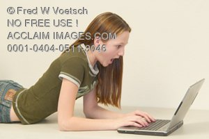 Stock Photo of a Young Girl With a Laptop