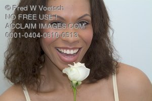 Stock Photo of a Happy Woman With a White Rose
