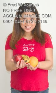 Stock Photo of a Pregnant Woman With Fruit in Her Hand
