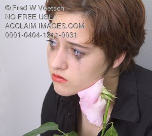 Stock Photo of a Sad Girl With a Pink Rose