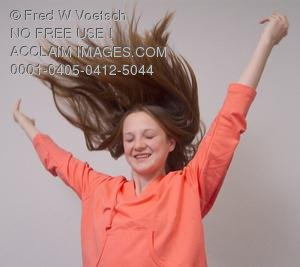 Stock Photo of a Girl With Her Arms Raised and Hair Flying