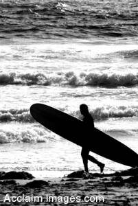 Black and White Stock Photo of a Surfer Walking On The Beach