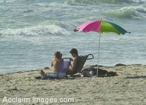 Stock Photo of a Couple Resting on a Sandy Beach