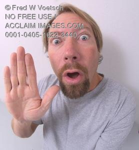 Stock Photo of an Upset Man Holding His Hand Up