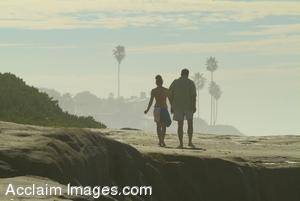 Stock Photo of a Couple Walking On the Beach