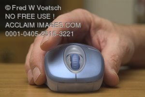 Stock Photo of a Hand Over a Computer Mouse