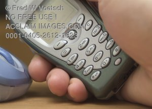 Stock Photo of a Hand Holding a Cell Phone