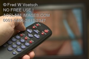 Stock Photo of a TV Remote Pointed Towards a TV