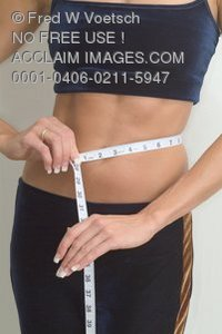 Stock Photo of a Woman Measuring Her Waist