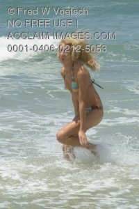 Stock Photo of a Woman Playing on the Beach