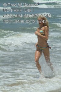 Stock Photo of a Woman Running in the Waves